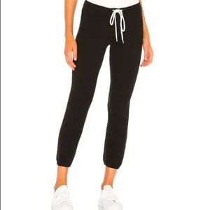 Revolve by the way. Satin Black Joggers White Side Pinstripe size XS